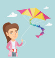 young caucasian woman flying kite vector image vector image