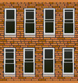 seamless brick wall with windows background vector image vector image
