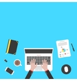 hands and office objects on blue desk top vector image vector image