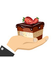 hand holding sweet cake vector image vector image