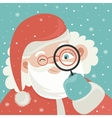 Portrait of Santa Claus with magnifying glass vector image