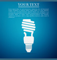 energy saving light bulb icon on blue background vector image vector image