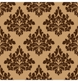 Damask seamless pattern in brown colors vector image vector image