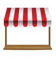 store window with striped awning -