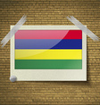 Flags Mauritius at frame on a brick background vector image