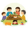 japanese family around kotatsu vector image vector image