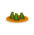 nasi lemak wrapped with banana leaf traditional vector image vector image