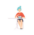 young woman with blue hair sitting in cafe and vector image vector image