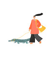 funny girl walks with a crocodile on a leash vector image