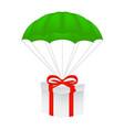 gift box at green parachute vector image
