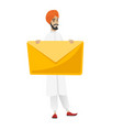 smiling businessman holding a big envelope vector image