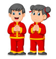 two children are giving a greeting vector image