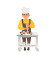 a boy or teenager in a chefs hat cooks cupcakes or vector image vector image