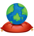 A globe above the red pillow vector image vector image