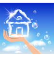 The hand holds a cloud house in the sky vector image