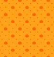 Orange seamless polka dots pattern with pumpkin vector image