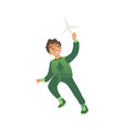 a little boy in green clothes runs with a toy vector image