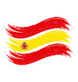 grunge brush stroke with national flag of spain vector image
