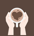 hand holding coffee cup with heart shape of foam vector image