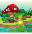 A frog standing near the red mushroom house vector image vector image