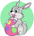 easter bunny holding an egg the character is vector image vector image