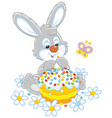 bunny with an easter cake vector image vector image