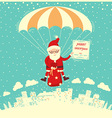 santa claus on parachute fly in winter sky vector image vector image
