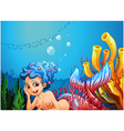 A mermaid near the coral reefs vector image vector image