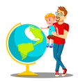 father and son looking at the globe vector image vector image