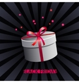 White gift box on black background vector image