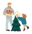 father with kid decorating christmas tree together vector image