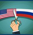 usa and russian flags are cut with scissors vector image