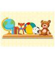 doll and ball on wooden shelf vector image vector image