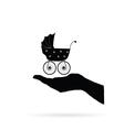 baby stroller in hand black vector image