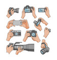 camera professional photocamera in hands vector image