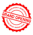 grunge red grand opening word round rubber seal vector image