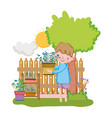 little boy lifting houseplant with fence and tree vector image