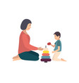 mom and son sitting on floor and building pyramid vector image vector image