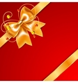 Golden bow of silk ribbon isolated on red vector image vector image