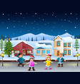 happy kids playing in front of the snowing village vector image vector image