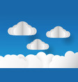 clouds isolated on blue background in paper cut vector image vector image