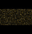 glitter of golden particles of confetti on a black vector image