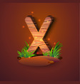 wooden letter x decorated with grass vector image vector image