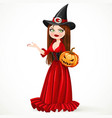 beautiful witch in a red dress holding a pumpkin vector image vector image