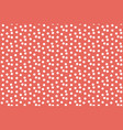 red pastel color background scattered dots vector image vector image