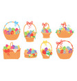 easter baskets painted chocolate eggs in wicker vector image