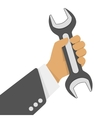 Wrench in hand vector image vector image