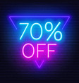 70 percent off neon lettering on brick wall vector image vector image