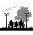 silhouette a family sitting on a park bench