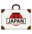 travel bag with japanese flag and the torii gate vector image